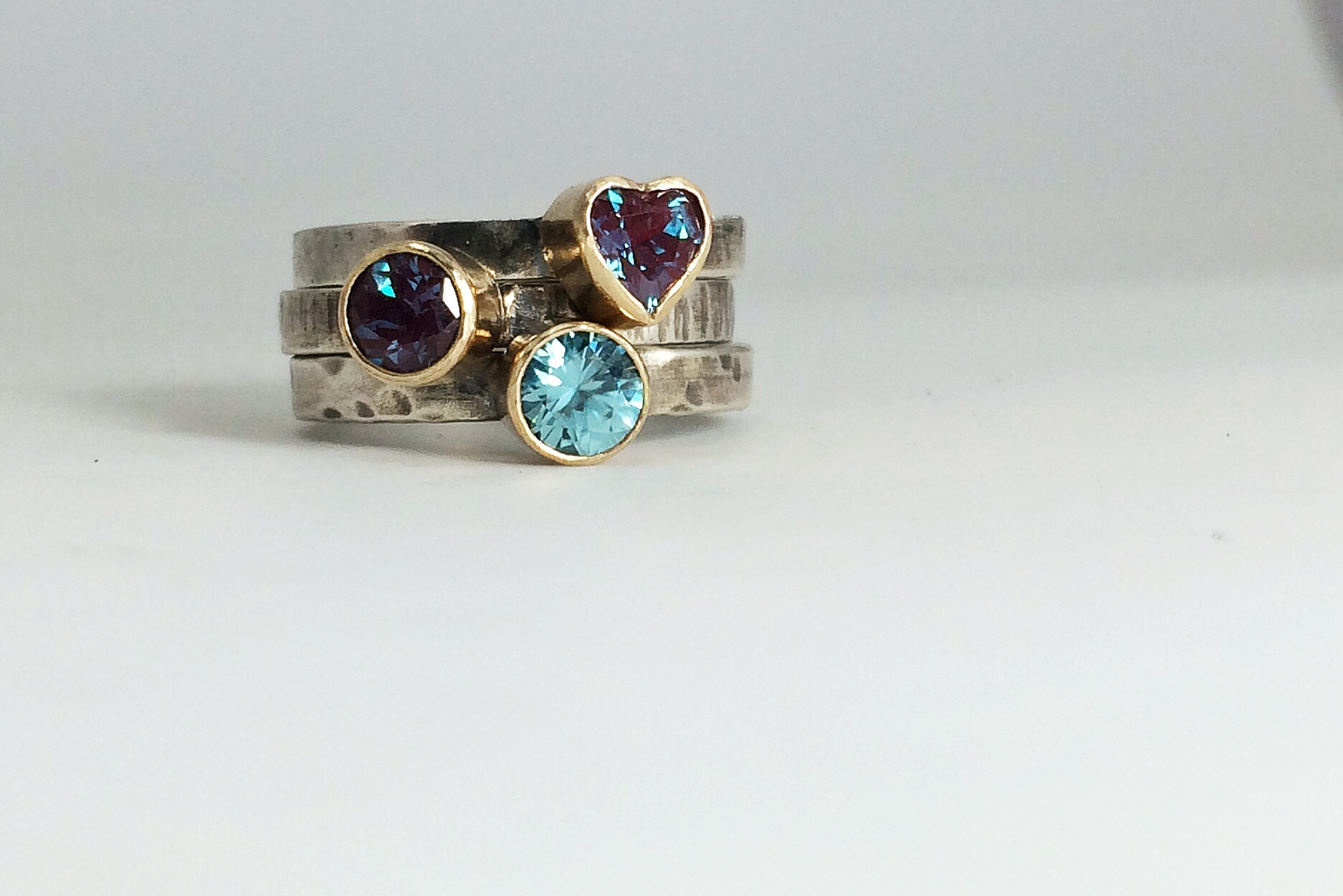 Stacking set of mother's rings - forged sterling shanks with patina, 14k bezels, alexandrite (June) and blue zircon (December)